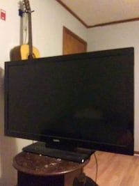 black flat screen TV with remote Addis, 70710