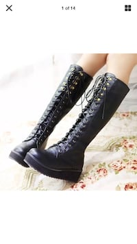 pair of women's black leather knee-high boots