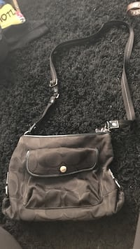 gray and black monogrammed Coach 2-way handbag