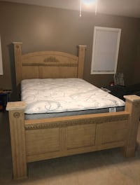 Queen Bed with frame, headboard and foot board . Mattress not included