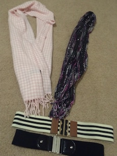 two pink and purple scarves and belts