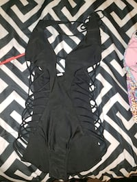 black one peice swimsuit  size medium.  but fits small never worn Pensacola, 32505