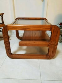 brown wooden framed glass top coffee table Port Orange