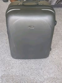 Large hard cover rolling suitcase  Vancouver, V6E 1S8