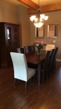 Urban barn dining table, eight chairs, and matching china cabinet. Langley, V2Y 2P9