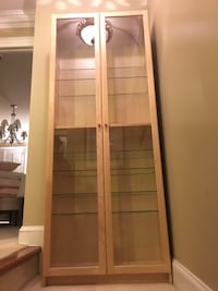 Light tanned 8 shelf cabinet in excellent shape