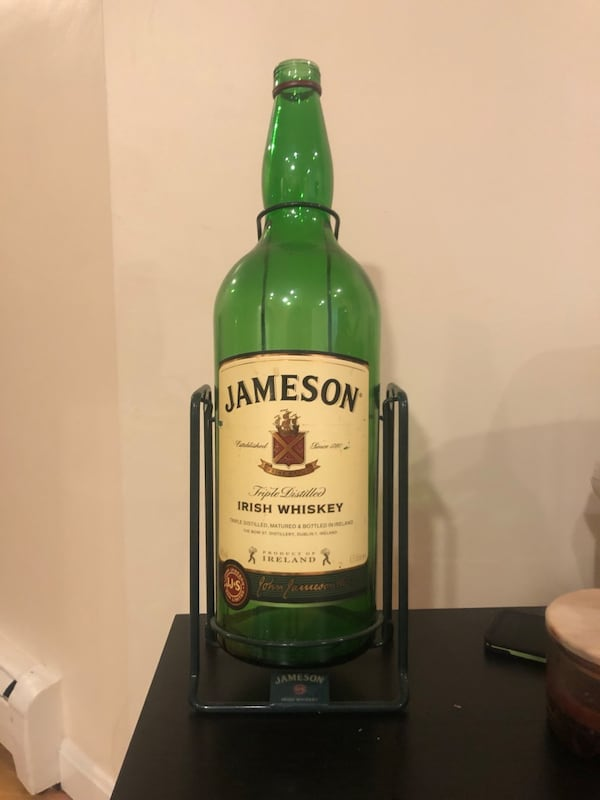 Swinging Jameson Stand with bottle d377812e-ca00-4584-869e-6b00d8cc5568