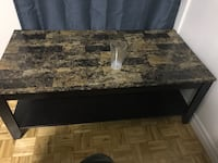 rectangular brown wooden coffee table