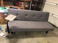 Nice grey futon that folds down to a laying position. Slight cat scratch on a corner. Redmond, 97756