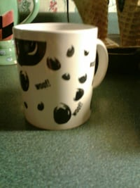 white and black ceramic mug