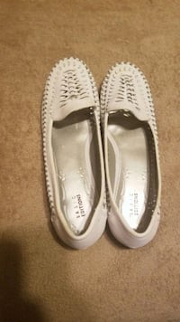 pair of white leather flats Anderson