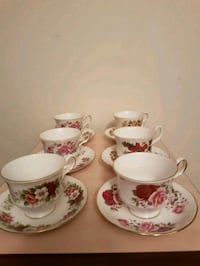 white-and-pink floral ceramic tea set 552 km