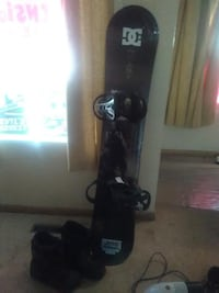 black and white snowboard with bindings null