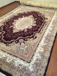White, brown, and black floral area rug
