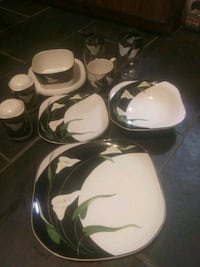 8 pc.set of black lilies dinner were made by Sanyo Quadruple