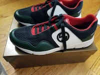 black-and-red Gucci low-top sneakers with brown box