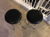 Two Leather Swivel Bar Stools