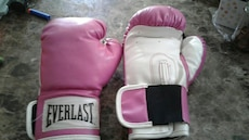 pair of pink-and-white Everlast training gloves