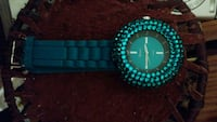 round teal and black analog watch with blue band Akron, 44312