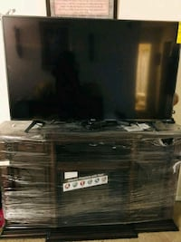 "55"" flat screen TV brown wooden TV stand Riverdale Park"