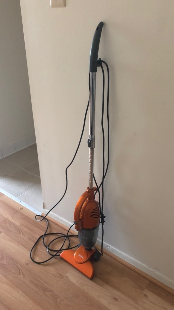 black and red steam mop