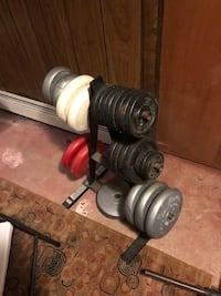 Weight Lifting Plates and Rack with barbell and clips East Greenbush, 12061