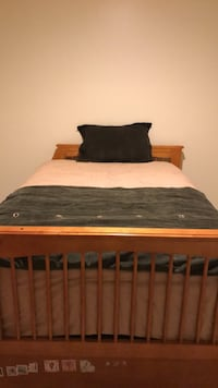 brown wooden bed frame with white mattress 51 km