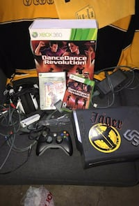 Xbox 360 console with controller and game cases New York
