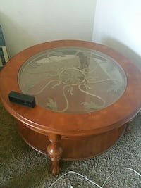 round brown wooden framed glass top coffee table Bakersfield, 93309