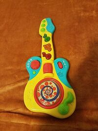 toddler's blue, red, and yellow plastic guitar toy Norwalk, 90650