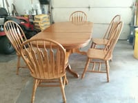 oval brown wooden table with six chairs dining set Acushnet, 02743