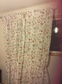 white, green and red floral print curtain