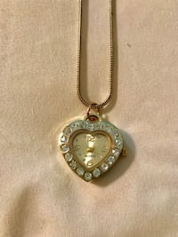 "A 16"" necklace with a clock pendent hanging on it. New Orleans, 70123"