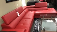 Bonded leather sectional with adjustable headrest.