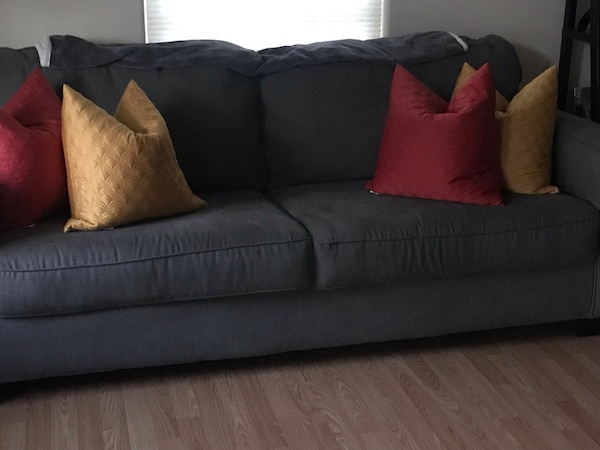 Gray sofa and chair sold as a set