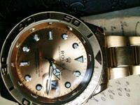 round gold-colored Rolex analog watch with link br Durham, 27707