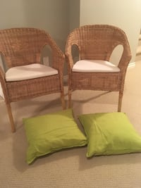 Two wicker chairs with cushions and throw pillows. Edmonton, T5M 0W2