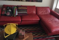 Red leather sectional sofa with throw pillows