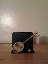 Tennis anyone? Gold and black color  tennis racket