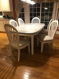 Dining Table with custom grey chalk painted top. Includes six chalk painted chairs with brand new grey and white striped upholstery. Miller Place, 11764