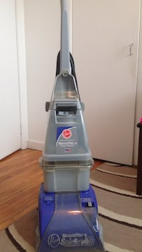 gray Hoover upright vacuum cleaner
