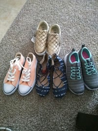 three pairs of assorted-color shoes 768 mi