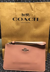 Coach Wristlet - New/Never Used. Original Price $95. Selling for $45 or BO. Start your holiday shopping early!  Will ship for extra cost   Houston, 77084