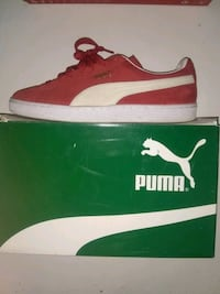 Red and white PUMAS low-top shoe with box