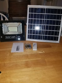 25 /60 watt solar light /with remote BRAND NEW (STILL IN BOXES)