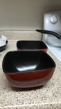 two black-and-red ceramic bowls