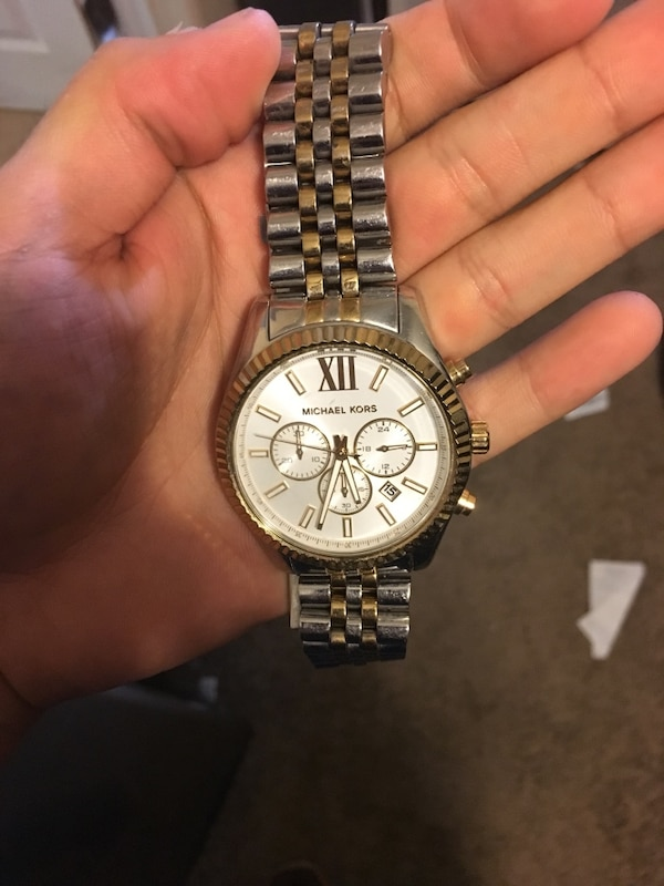 Round silver michael kors chronograph watch with gold and silver link bracelet