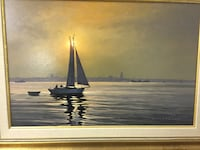 white sailboat on body of water painting with yellow frame