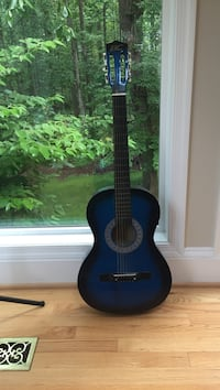 Blue and black classical guitar 23 km