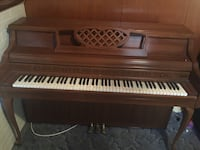 brown wooden upright piano Columbia, 21044